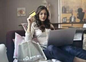 woman with credit card in hand ready to make online sale