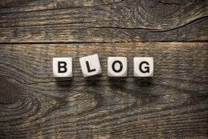 blog cubes on wooden background symbolizing the important of Why people need blogs