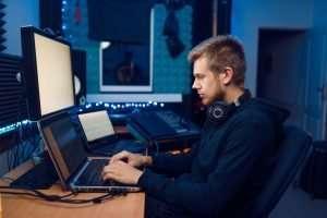 man at computer ransomeware attack
